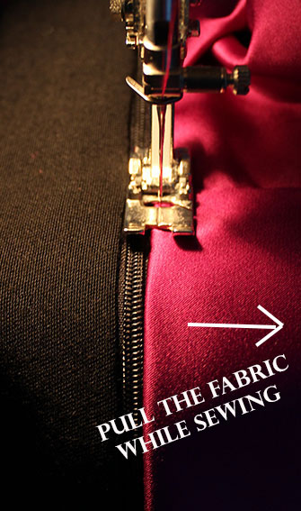stitching the edge of the zipper